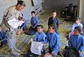CPT Anita Boone hands out school supplies to students in the Panjshir Valley (4652678010).jpg