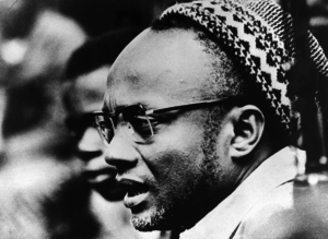 Amílcar Cabral - Amílcar Cabral wearing a traditional skullcap known as a sumbia during the 1964 Cassacá Congress, a gathering of PAIGC cadres.
