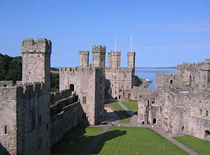 Glyndŵr Rising - The ward of Caernarfon Castle, besieged by Glyndŵr in 1403, showing (from left to right) the Black Tower, the Chamberlain's Tower, and the Eagle Tower.
