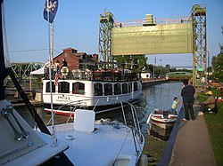 The Emita II passes through Lock 24 across from Paper Mill Island in downtown Baldwinsville.