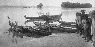 Wa (watercraft) - Close up of wa beached at Truk Lagoon, 1899-1900.