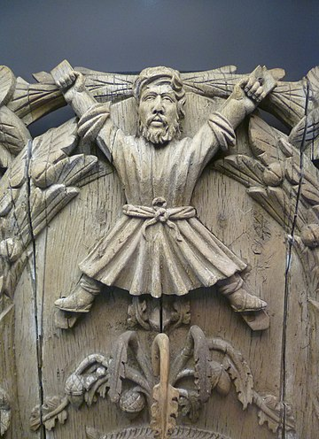 Saint Andrew depicted on a 16th-century coat of arms of the burgh of St. Andrews Carving of Saint Andrew.JPG