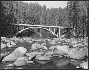 Collawash River - A deck arch bridge over the river, pictured in 1957