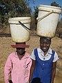 Children carrying buckets of water.jpg