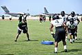 Chris Wiesehan, left, an assistant coach for the University of Hawaii football team, runs a drill during a practice at Joint Base Pearl Harbor-Hickam Aug. 15, 2013, in Hawaii 130815-N-IU636-247.jpg