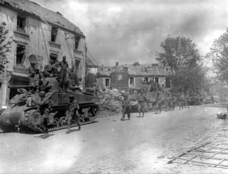 Allied advance from Paris to the Rhine - M4 and M4A3 Sherman tanks and infantrymen of the U.S. 4th Armored Division advancing through Coutances.