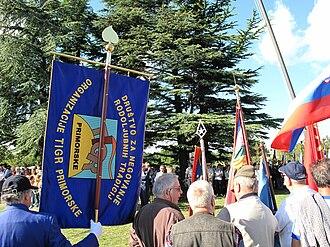 TIGR - Members of the Patriotic Association TIGR at the commemoration of the 80th anniversary of the Victims of Basovizza in Basovizza near Trieste, Italy