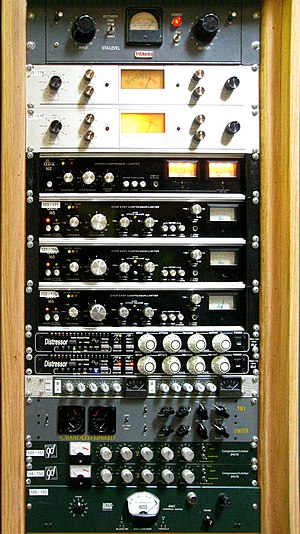 A rack of audio compressors in a recording studio. From top to bottom: Retro Instruments/Gates STA level; Spectra Sonic; Dbx 162; Dbx 165; Empirical Labs Distressor; Smart Research C2; Chandler Limited TG1; Daking FET (91579); and Altec 436c. Comp. rack (Supernatural).jpg