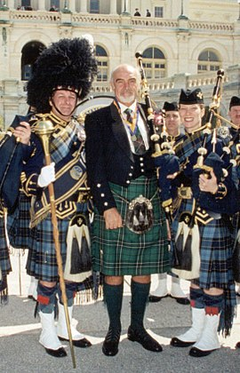 Connery at a Tartan Day celebration in Washington, D.C. When knighted by Queen Elizabeth II in 2000 he wore a green-and-black hunting tartan kilt of his mother's MacLean clan. ConneryKilt.jpg