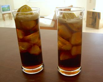 Rum and Coke - Two Cuba Libres with lemon garnish