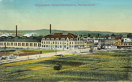 A colorized photo from 1911 of the Daimler-Motoren-Gesellschaft factory in Untertürkheim. Today, this building is the seat of Daimler AG. Daimler-motoren-gesellschaft-1911.jpg