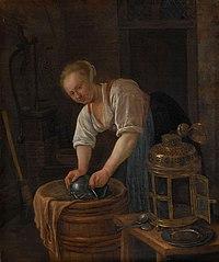 Woman scouring metalware