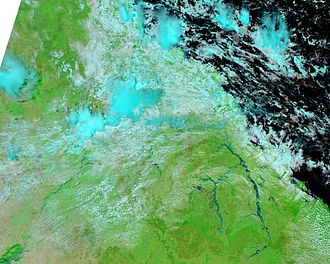 2010–11 Queensland floods - NASA image showing swollen rivers and cloud cover.