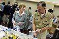 Defense.gov News Photo 100702-N-0696M-096 - Chairman of the Joint Chiefs of Staff Adm. Mike Mullen and his wife Deborah participate in a USO care package packing party in the Pentagon on July.jpg