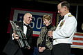 Defense.gov News Photo 110412-N-TT977-185 - USO Chairman of the Board of Directors John Marselle presents Chairman of the Joint Chiefs of Staff Adm. Mike Mullen and his wife Deborah with a.jpg