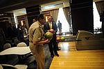 Defense.gov News Photo 111004-F-RG147-1154 - Field Marshal Hussein Tantawi and Secretary of Defense Leon Panetta enjoy an impromptu game of bowling while passing through a hotel s gallery in.jpg