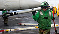 Defense.gov News Photo 120208-N-OY799-189 - Petty Officer 3rd Class May Enjambre carries a cargo hook on the flight deck of the aircraft carrier USS John C. Stennis CVN 74 during a.jpg