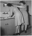 Demonstrating to each other correct posture in housework - NARA - 197185.tif