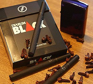 English: Djarum blacks, pack and cigarettes. A...