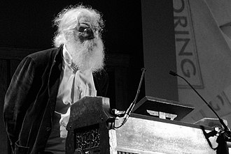 Photograph of Irving Finkel standing behind a lectern