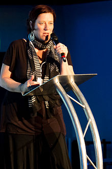 Rachael Dunlop speaking at a podium at QED 2013 in Manchester UK