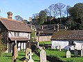 Dunster Priory churchyard, old house and view to Castle - geograph.org.uk - 103649.jpg