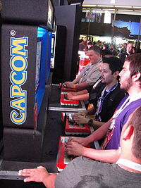 Visitors playing the crossover game Street Fighter X Tekken at the E3 2011