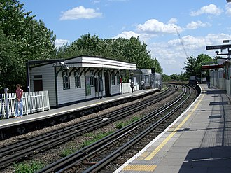 East Acton tube station - Looking east, with the eastbound platform shelter on the left.