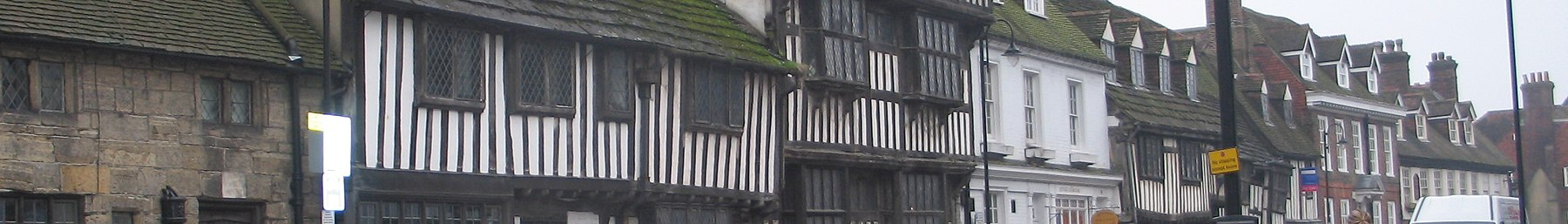 a row of 14th century timber framed buildings on the High Street