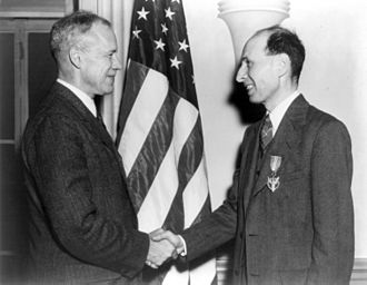 Eugene Wigner - Wigner receiving the Medal for Merit for his work on the Manhattan Project from Robert P. Patterson (left), March 5, 1946