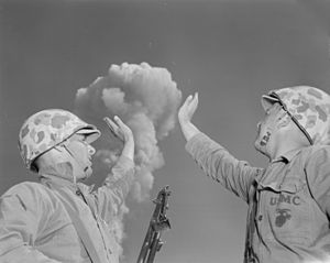 Poth and Wilson playing with the atomic mushroom of Dog test during Buster-Jangle operation (1952)