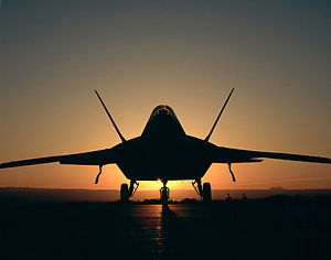 F-22 Raptor, silhouetted - 021105-O-9999G-073