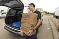 FEMA - 38546 - US Coast Guardsman puts MREs in a resident's trunk in Texas.jpg