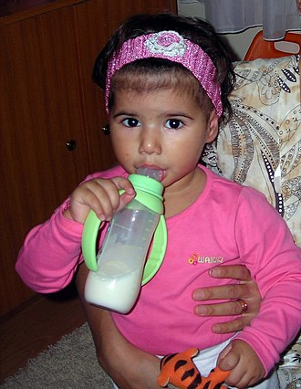 Baby bottle - A girl using a bottle