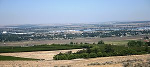 Finley, Washington - Finley shown with industrial complexes along Columbia River and orchards in the foreground
