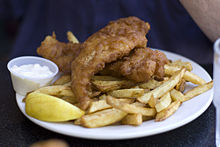 Cod and chips, served with a lemon wedge and tartar sauce