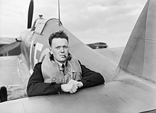 Flight Lieutenant P S Turner of No. 242 Squadron RAF, rests on the tail elevator of his Hawker Hurricane Mk I, after landing at Fowlmere, near Duxford in Cambridgeshire, September 1940. CH1376.jpg