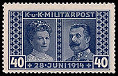 "The bluish-tinted stamp shows Sophia, duchess of Hohenberg on the left, and Franz Ferdinand on the right. The stamp is titled ""Militärpost"" (""Military Mail"") at the top, and the date of the couple's deaths at the bottom."