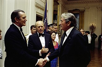 Malcolm Fraser - Fraser at a White House state dinner in 1976, being introduced to actor Gregory Peck by President Gerald Ford.