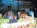 Fruit shop with women.JPG