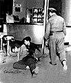 Fulgencio Oroz tries to lift Fructuoso Rodriguez. April 20, 1957, Havana.jpg