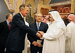 George H. W. Bush shakes hands with newly crowned King Abdullah.jpg