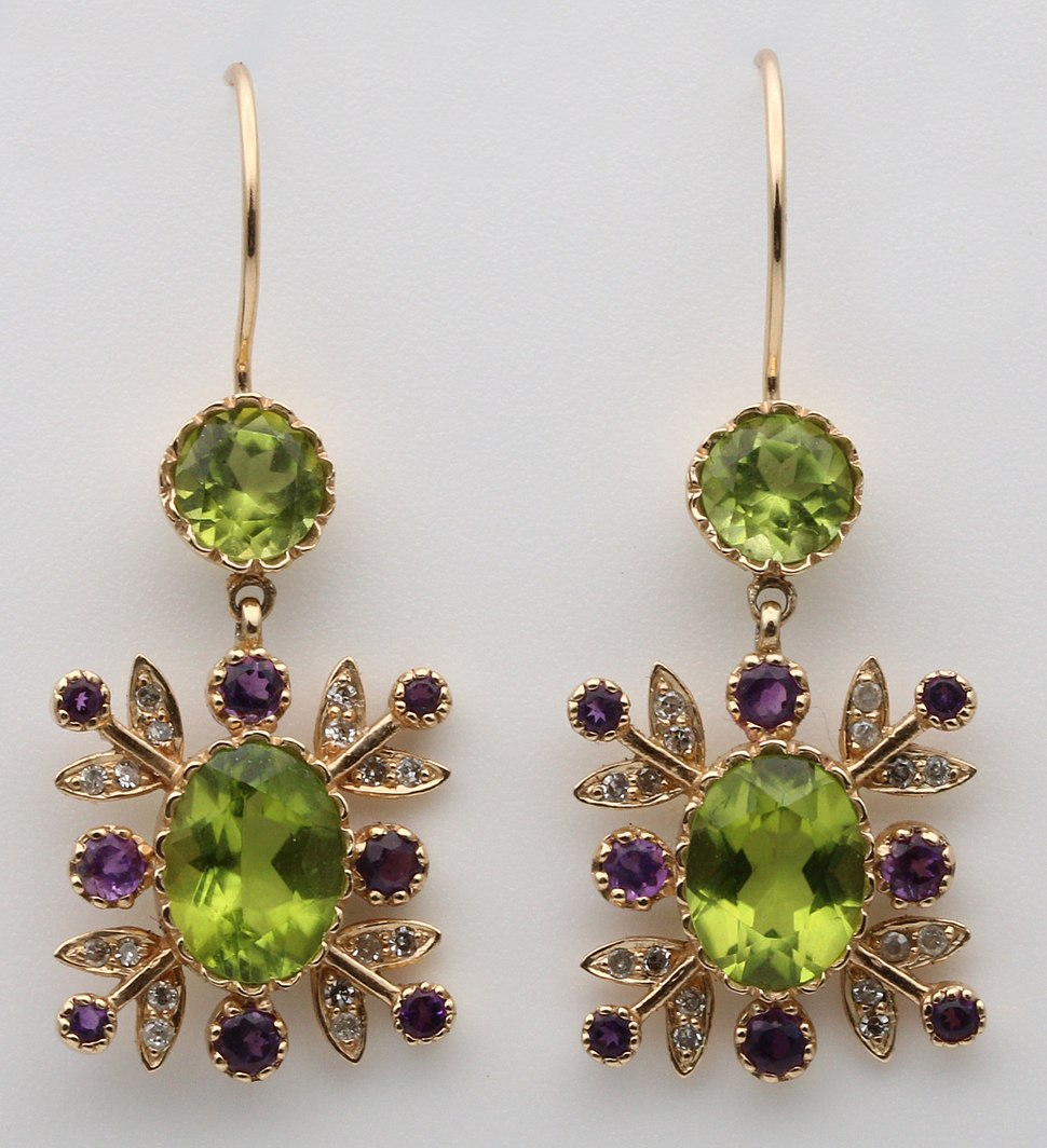 Gold ear rings in suffragette colours