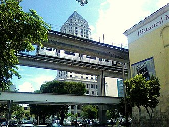 Government Center station (Miami) - Government Center with the Dade County Courthouse in the background and the Historical Museum of Southern Florida in the foreground on the right