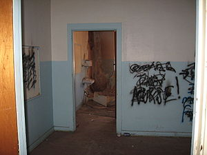 Occupancy - The interior of a vacant building showing signs of vandalism and decay