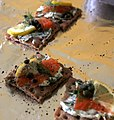 Gravlax on crackers with pepper and lemon.jpg