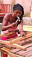 Guinean Woman Works Construction Three.jpg