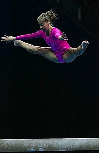 Gymnast jumping on beam.jpg