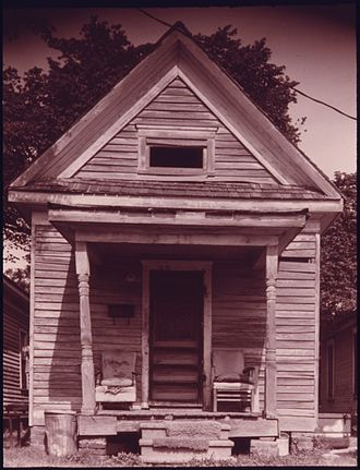 Shotgun house - Shotgun house in the Fifth Ward neighborhood of Houston, Texas, 1973, as pictured in a photo by Danny Lyon.