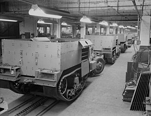 M2 Half Track Car - Partly finished M2s travel along an assembly line.